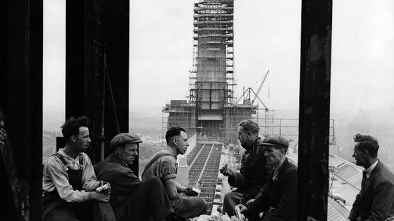 Builders of the 300 ft tall chimney stacks take a break and admire the view