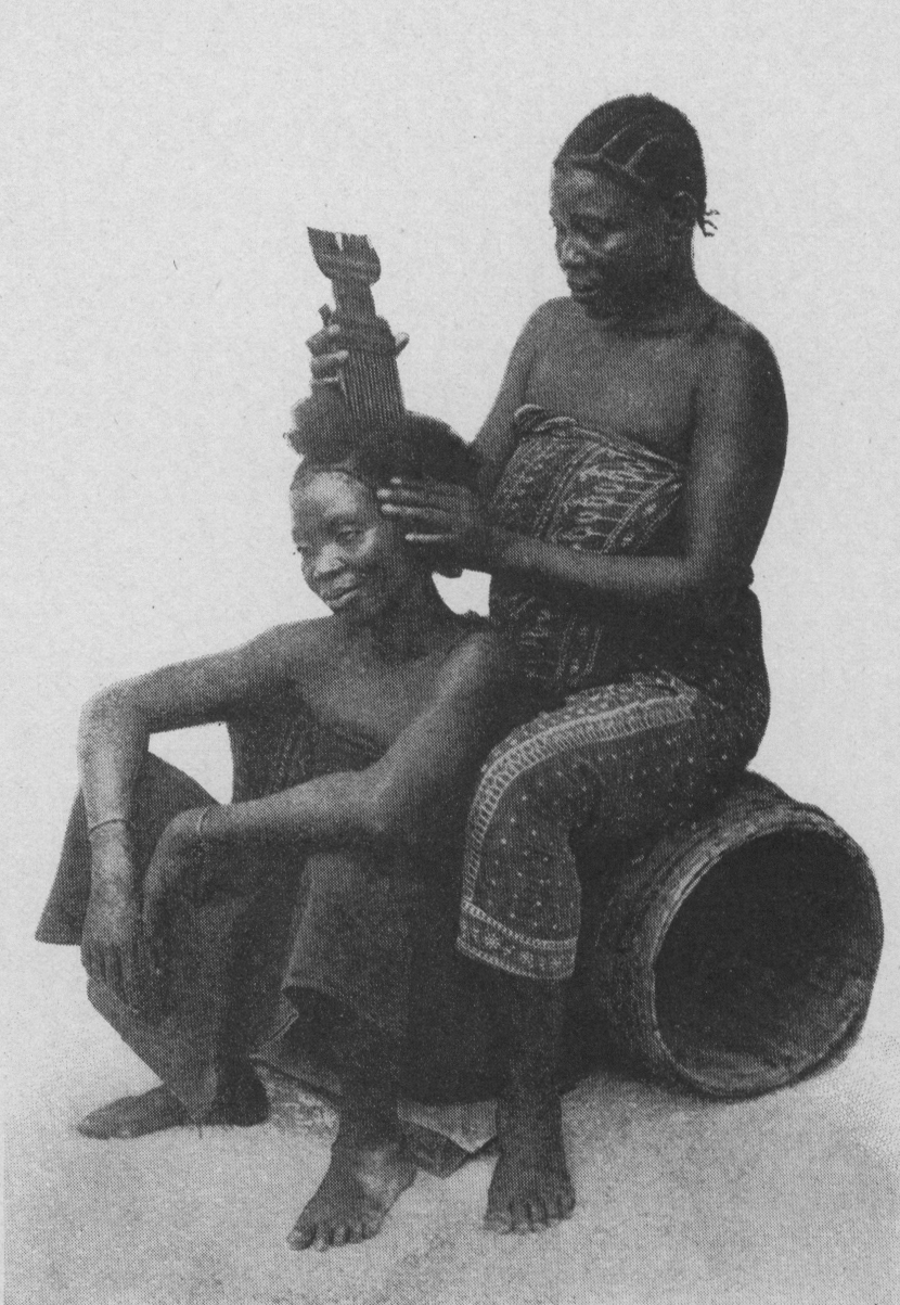 East-African women doing each other's hair (c) UPenn University