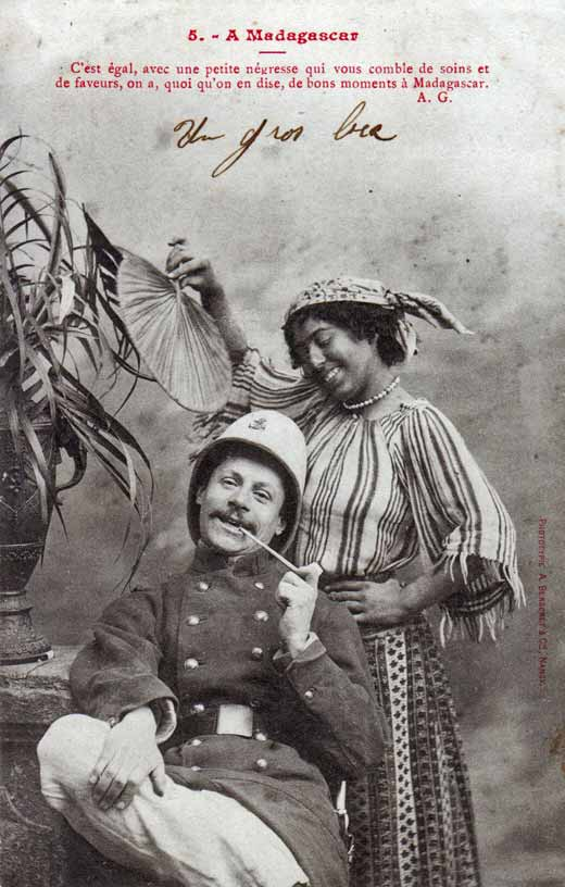"This French postcard reads: ""It's all the same, with a little negress taking care of your needs and showing you favor, it doesn't matter what people say, these are good times in Madagaskar."""