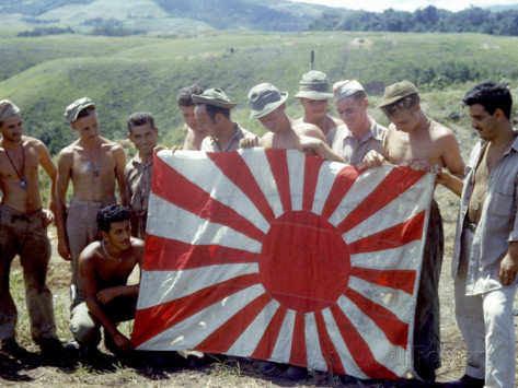 american-soldiers-holding-captured-japanese-flag-on-guadalcanal-island-during-wwii