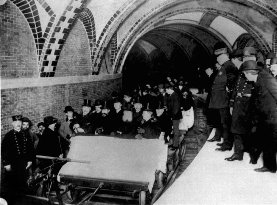 This group of financiers and city officials get a tour of New York City's first subway in January 1904 while the city's policemen stood by on the platform at City Hall Station. Seated toward the front of the ceremonial flat car are Alexander Orr, August Belmont, John B. McDonald, and Mayor George B. McClellen. (AP Photo/NYC Transit Authority)