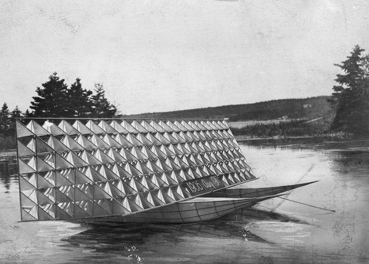 Cape Breton Island, Nova Scotia, Canada --- Alexander Graham Bell's tetrahedral kite is towed on the water. --- Image by © National Geographic Creative/Corbis