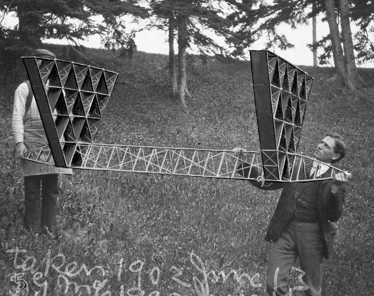 Cape Breton Island, Nova Scotia, Canada --- Alexander Graham Bell assistants hold an experimental kite. --- Image by © Bell Collection/National Geographic Creative/Corbis