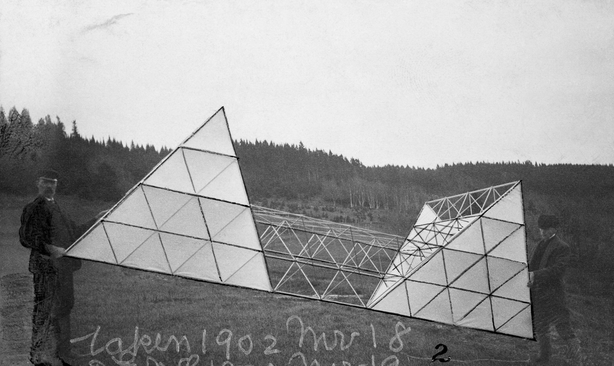 Cape Breton Island, Nova Scotia, Canada --- Men hold up Alexander Graham Bell's multicelled tetrahedral kite. --- Image by © Bell Collection/National Geographic Creative/Corbis