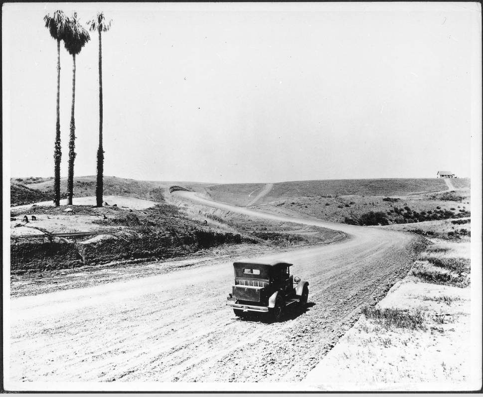 automobile_driving_down_sunset_boulevard_during_the_roads_construction_ca1925