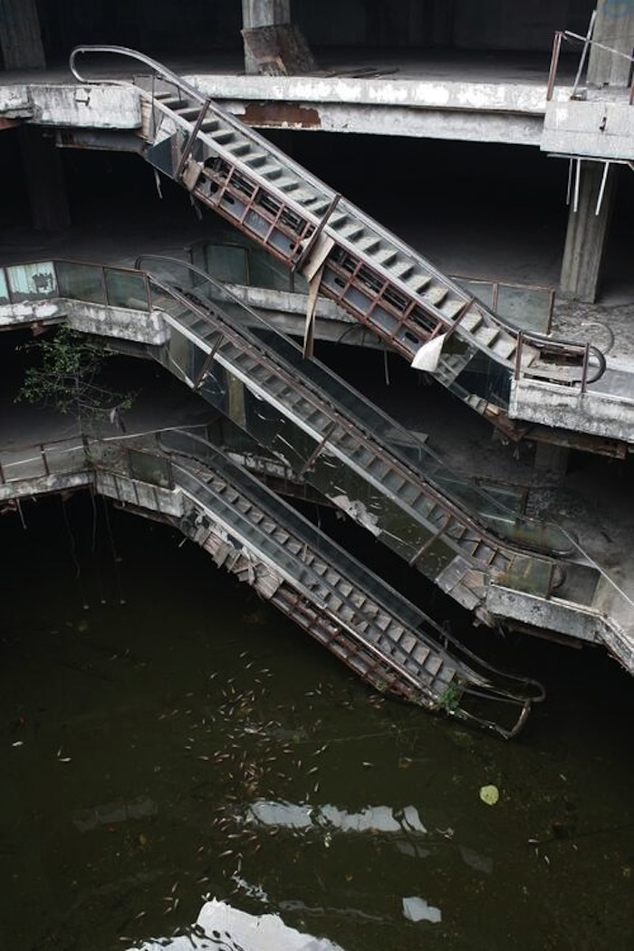 Oh just an abandoned shopping mall turned giant fish pond for Giant koi pond