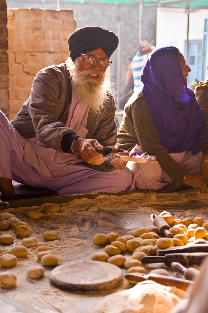 Tossing the bread on down the assembly line, Gurdwara Bangla Sah