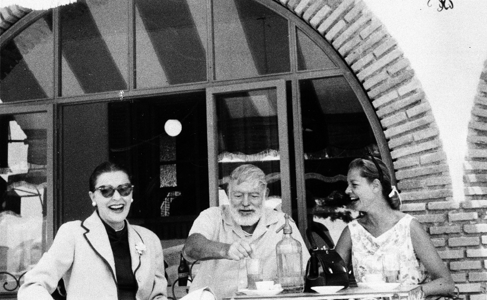 "EH4474P ca. 1950's Ernest Hemingway, Lauren Bacall, and Veronica Cooper (also known as Rock Cooper) drinking in a cafe. Cuba. Copyright unknown. Please credit: ""Ernest Hemingway Collection in the John F. Kennedy Presidential Library and Museum, Boston"""