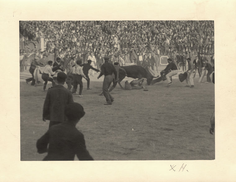 "EH 7891P Ernest Hemingway fighting a bull in ""The Amateurs"", Pamplona, Spain 1925. (""X H."" on border below image). Photograph in the Ernest Hemingway Photograph Collection, John F. Kennedy Presidential Library and Museum, Boston."