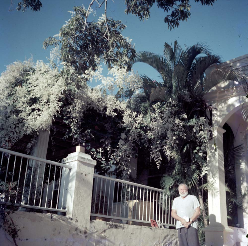 EH-C217T 1950s? Ernest Hemingway outside of his home, Finca Vigia, San Francisco de Paula, Cuba.