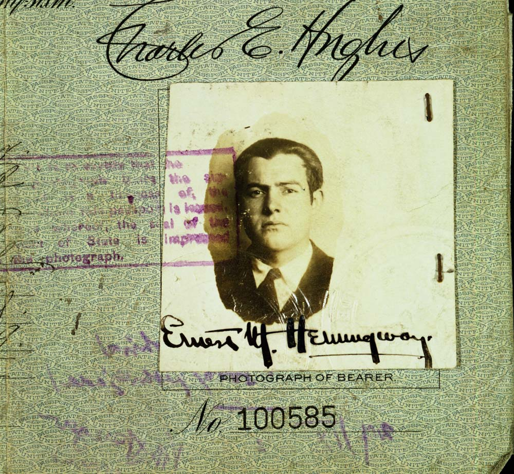 "EH-C6163D 1921 Detail of photograph from Ernest Hemingway's 1921 United States Passport, with his signature across the bottom of the image. Passport number 100585, with stamp and other writing at edges. Photograph in the Ernest Hemingway Collection of the John F. Kennedy Presidential Library and Museum, Boston. Scanned from 4x5"" copy negative by LAA DAMS 2B."