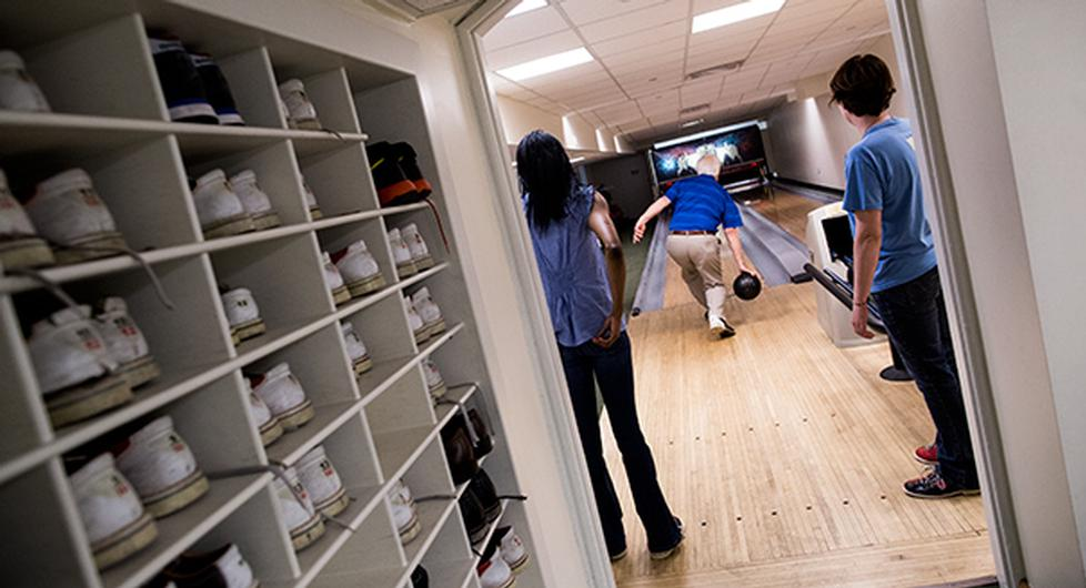 Once shoes are on, guests are free to enter the two-lane facility, pick out a ball from the racks and begin scoring. (M. Scott Mahaskey/POLITICO)