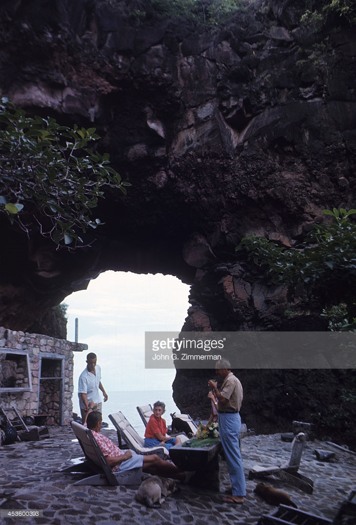 Sports Architecture: Tom Johnston and his wife, Gladys, with guests on the roof of their volanic house called Moonhole. The couple is building a multi-layered home out of lava, whale ribs, and mortar. Bequia, Saint Vincent and the Grenadines 11/20/1966 CREDIT: John G. Zimmerman (Photo by John G. Zimmerman /Sports Illustrated/Getty Images) (Set Number: X12055 )