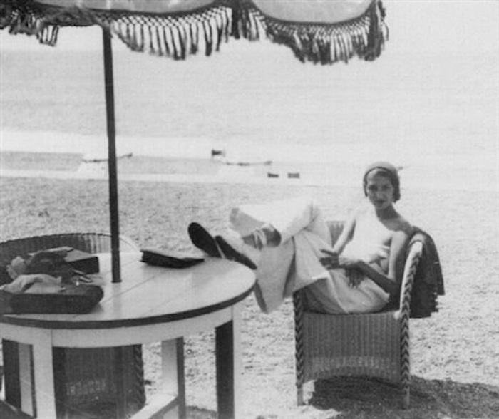 jacques-henri-lartigue-renee-perle,-in-cane-chair-under-sun-umbrella,-biarritz