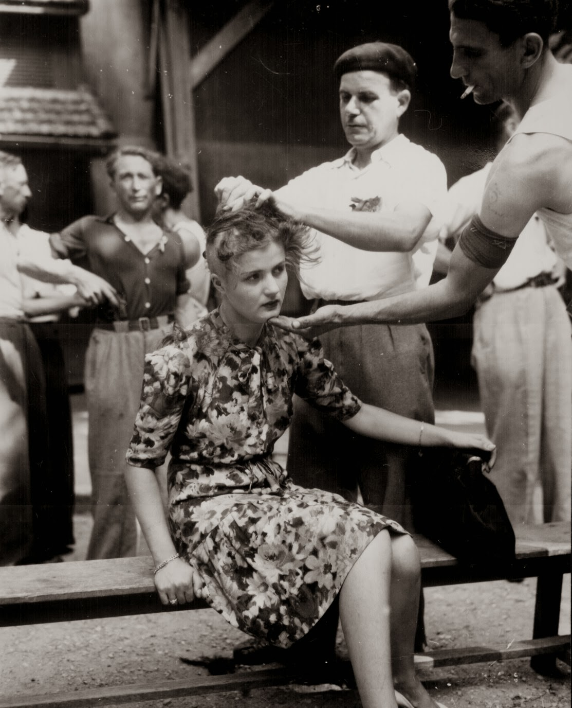 a-french-woman-has-her-head-shaved-by-civilians-as-a-penalty-for-having-consorted-with-german-troops-1944
